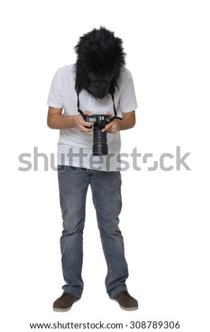 Gorilla man with a DSLR camera. - stock photo