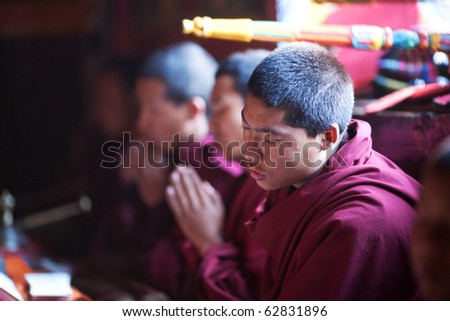 GORKHA, NEPAL - NOVEMBER 28: Buddhist monk during puja ceremony in a monastery on November 28, 2009 in Gorkha District, Nepal.