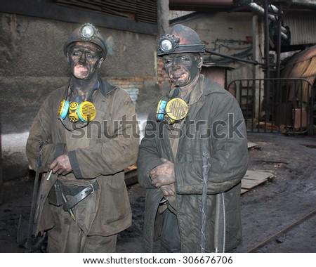 Gorlovka, Ukraine - December 10, 2012: Miners mine named Rumyantsev after work shift - stock photo