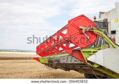 Gorna Oryahovitsa - June 27: Agricultural landscape - harvesting wheat from large agricultural areas against the blue sky on June 27, 2015, Gorna Oryahovitsa, Bulgaria - stock photo