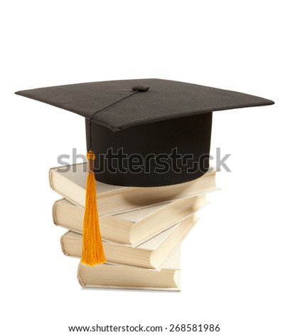 Gortarboard and book, isolated on white - stock photo
