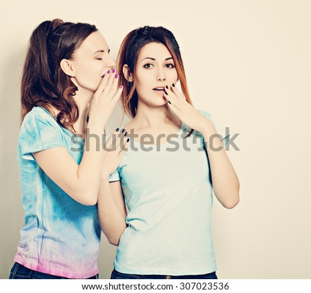 Gossip. Woman Whispers to the Friend Secrets. Cute Girls Talking - stock photo