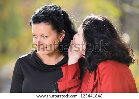 Gossips. Two women gossiping with each other