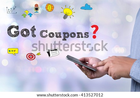Got Coupons?  person holding a smartphone on blurred cityscape background - stock photo