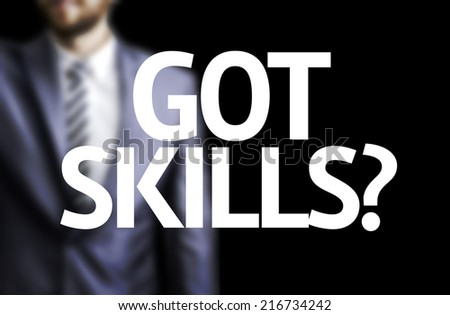 Got Skills? written on a board with a business man on background - stock photo