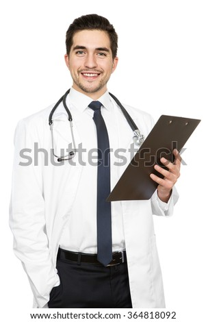 Got some health news. Vertical studio shot of a handsome doctor holding a clipboard isolated on white  - stock photo