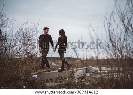 Goth couple outdoors love story.
