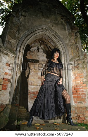 goth girl in black dress near crypt - stock photo