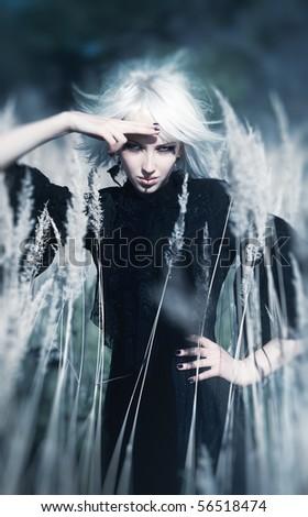 Goth woman outdoors portrait. Selective focus effect. - stock photo