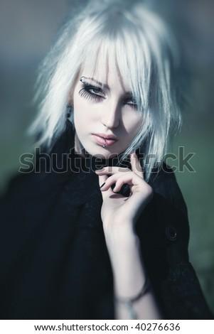 Goth woman portrait. Selective focus effect. - stock photo