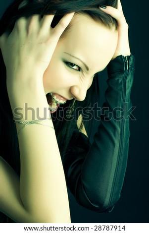 Goth woman portrait. Soft green tint. - stock photo