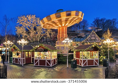 GOTHENBURG, SWEDEN - DECEMBER 17, 2015: Christmas Market with Carousel in the Liseberg park. It is one of the most visited amusement parks in Scandinavia and the most famous Christmas Market of Sweden - stock photo