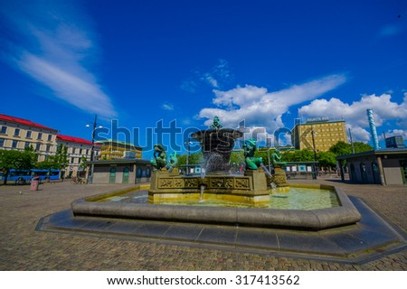GOTHENBURG, SWEDEN - JUNE 21, 2015: Five Continents water fountain in Jarntorget Square in Gothenburg downtown