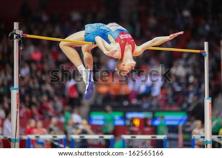 GOTHENBURG, SWEDEN - MARCH 1 Dimitry Semenov (RUS) competes in the qualification of the men's high jump event during the European Athletics Indoor Championship on March 1, 2013 in Gothenburg, Sweden. - stock photo