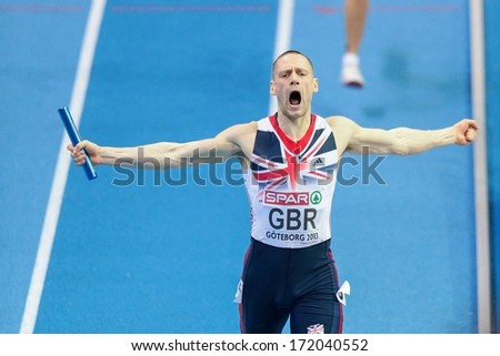 GOTHENBURG, SWEDEN - MARCH 3 Richard Stranan (Great Britain) and his team win the men's 4x400m relay finals during the European Athletics Indoor Championship on March 3, 2013 in Gothenburg, Sweden. - stock photo