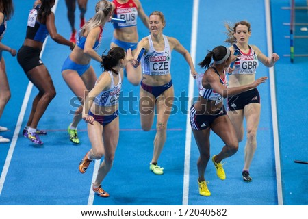 GOTHENBURG, SWEDEN - MARCH 3 Shana Cox (Great Britain) and her team win the women's 4x400m relay finals during the European Athletics Indoor Championship on March 3, 2013 in Gothenburg, Sweden. - stock photo