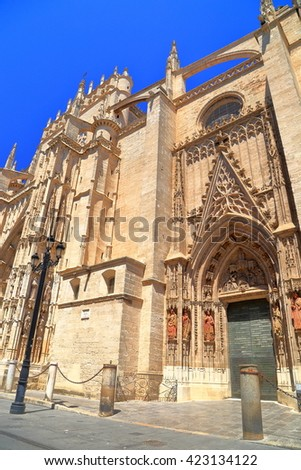 Gothic architecture of the Cathedral of Saint Mary of the See (Seville Cathedral) in Seville, Andalusia, Spain - stock photo