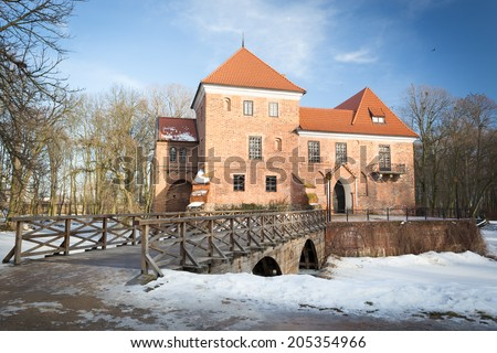 Gothic castle in Oporow during winter time - stock photo