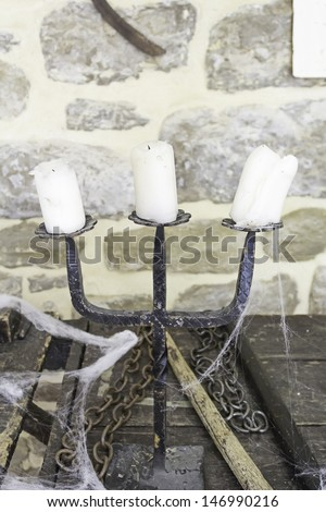 Gothic Chandelier with wax candles and cobwebs, halloween and event - stock photo