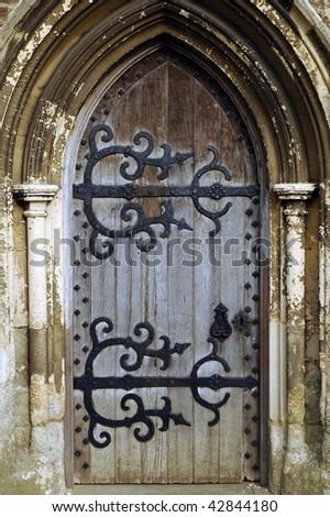 Gothic church door with elaborate ironwork - stock photo