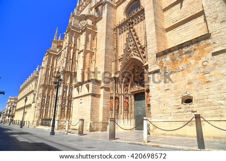 Gothic exterior of the Cathedral of Saint Mary of the See (Seville Cathedral) in Seville, Andalusia, Spain - stock photo