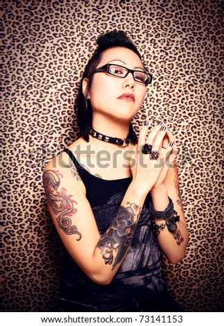 Gothic girl and leopard print background - stock photo