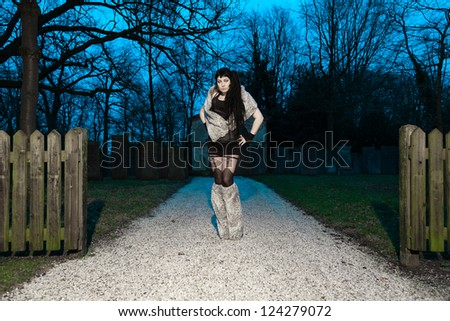 Gothic girl on cemetery. - stock photo