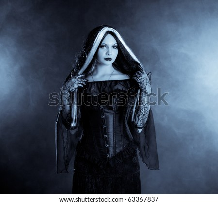 Gothic girl on smoke background - stock photo