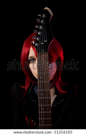 Gothic girl with guitar, selective focus on guitar, isolated on black background