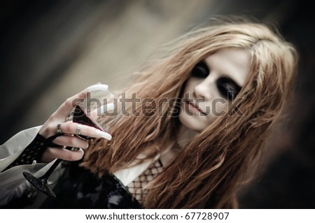 Gothic girl with wine