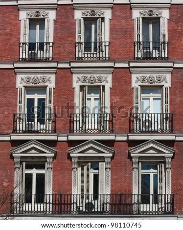 brick apartment building. Gothic Neo Classical Style Windows Brick Apartment Building in Madrid Spain  Europe Stock Photo 98110745