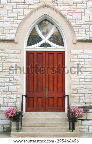 Gothic oak wooden church doors with ornate metal hardware - stock photo