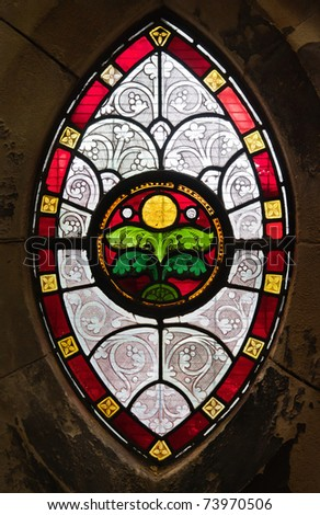 Gothic Ornamental Stained Glass Window In A Medieval Church
