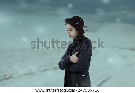 Gothic picture of a beautiful girl in winter hat - stock photo
