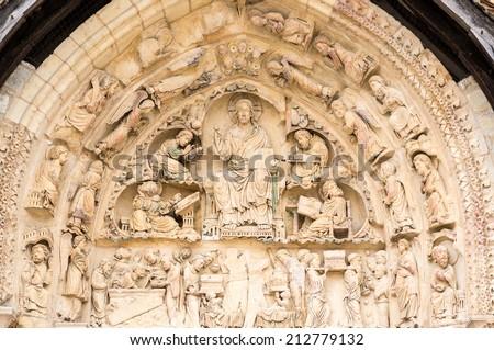 Gothic Sculptures on the west facade of the Abbey of Fleury, Saint Benoit sur Loire, Loiret, France - stock photo