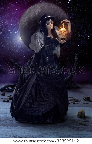 Gothic sorceress casting some spells - stock photo