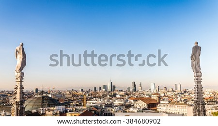Gothic spire on the roof of Milan Dome with city landscape as background. Milan, Italy. - stock photo