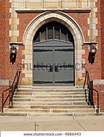 Gothic-style double doors at the front of a church in Northeastern Ohio