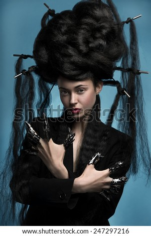 Gothic style shot of a woman with claw rings - stock photo