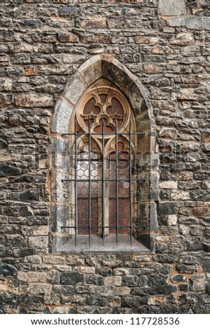 Gothic window at the wall of the church - stock photo