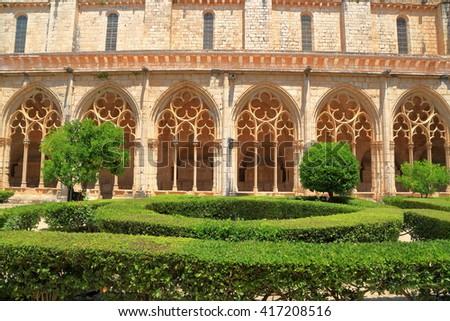 Gothic windows along the patio inside the cloister of the Monastery of Santa Maria de Santes Creus in Catalonia, Spain - stock photo