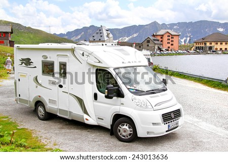 GOTTHARD PASS, SWITZERLAND - AUGUST 5, 2014: White Fiat Ducato based Laika campervan at the high Alpine mountain road. - stock photo