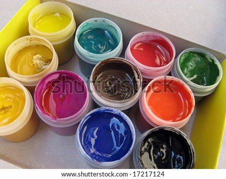Gouache paint cans in the box - stock photo