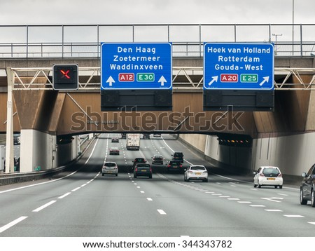 GOUDA, NETHERLANDS - APR 22, 2015: Gouwe aqueduct on motorway A12 - route information to The Hague and Rotterdam