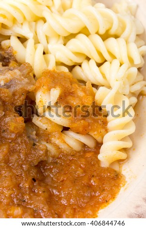 Goulash with beef meat served with macaroni.