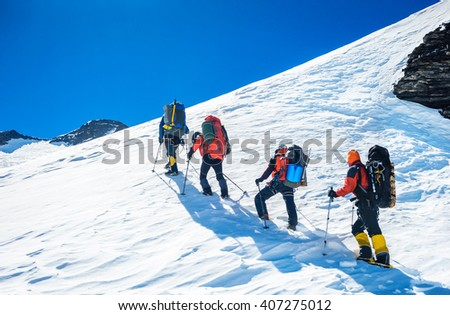 Goup of climbers reaching the simmit. Team work concept - stock photo