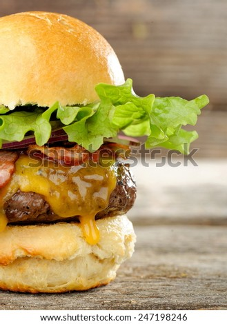 Gourmet bacon cheeseburger with lettuce and tomato - stock photo