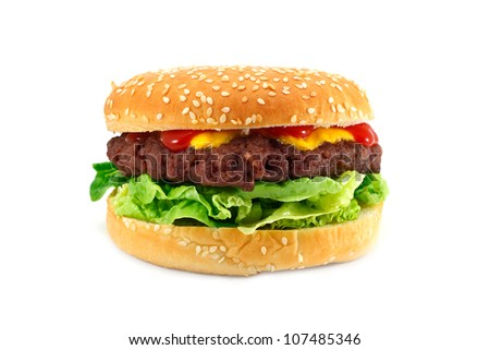gourmet cheeseburger with a homemade beef patty on a bed of lettuce with ketchup - stock photo