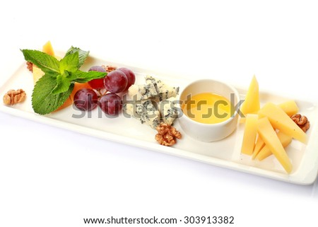 Gourmet cheeses with honey, food - stock photo