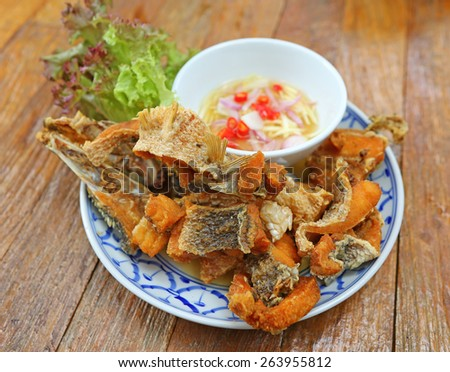 Gourmet chunks of fried Asian style snapper served with chili fish sauce - stock photo